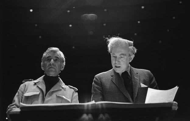Leonard Bernstein and Elliott Carter looking over a score.