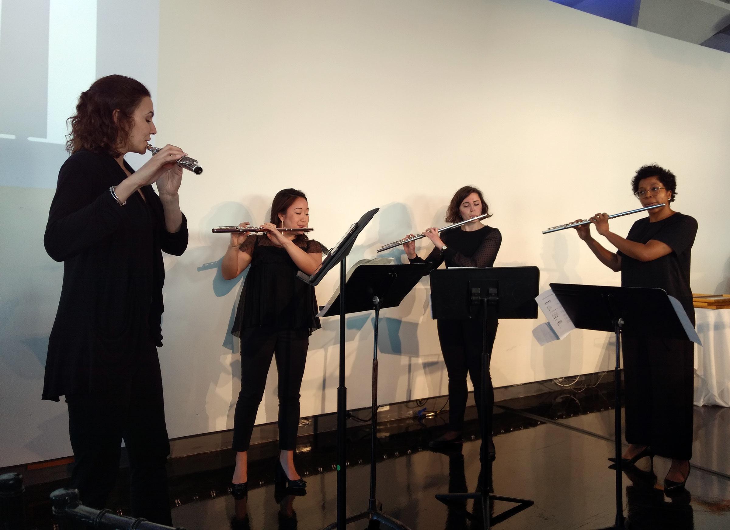 Flute quartet performance during the ceremony.