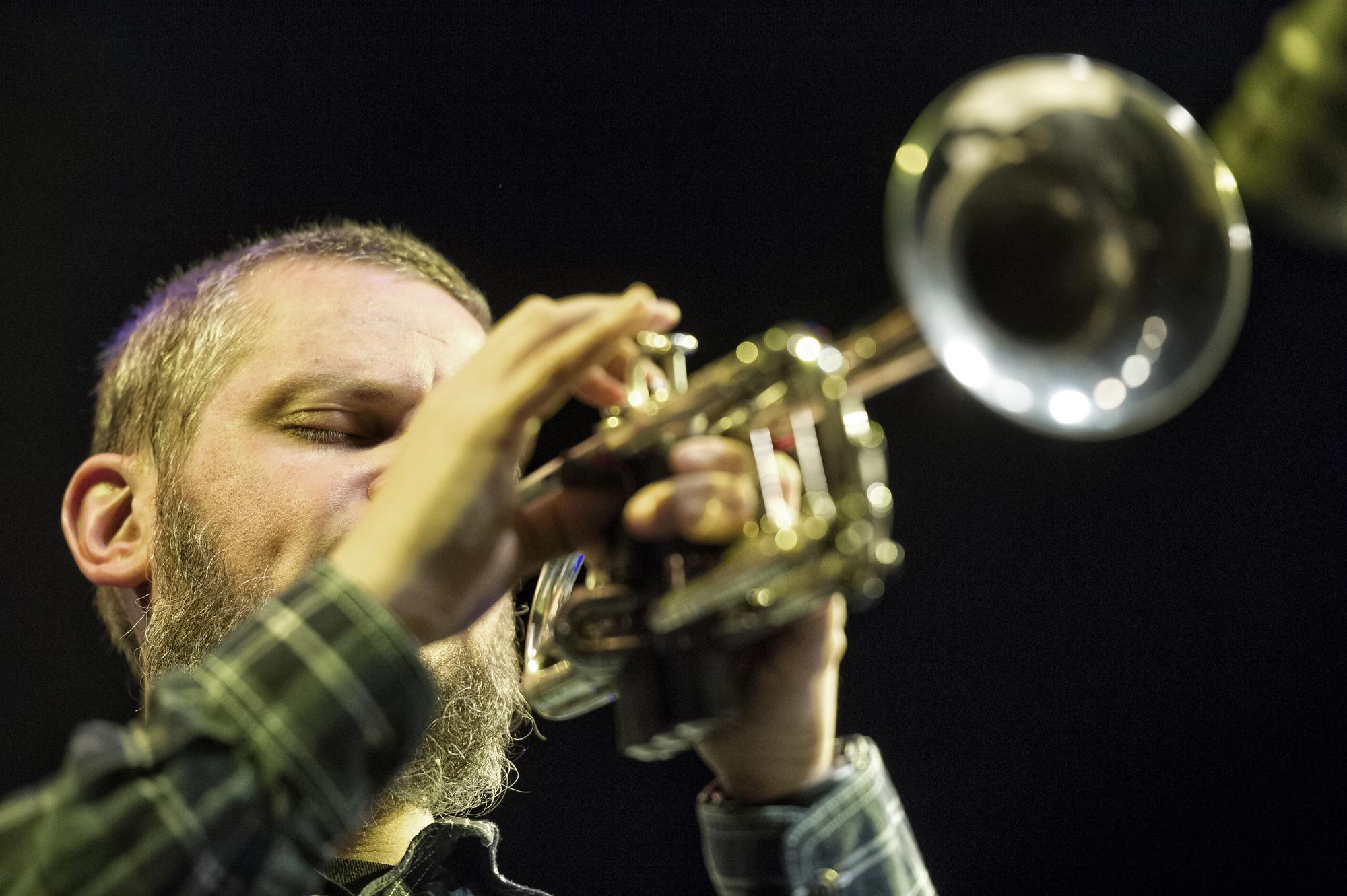 Nate Wooley playing a trumpet (photo by Ziga Koritnik)