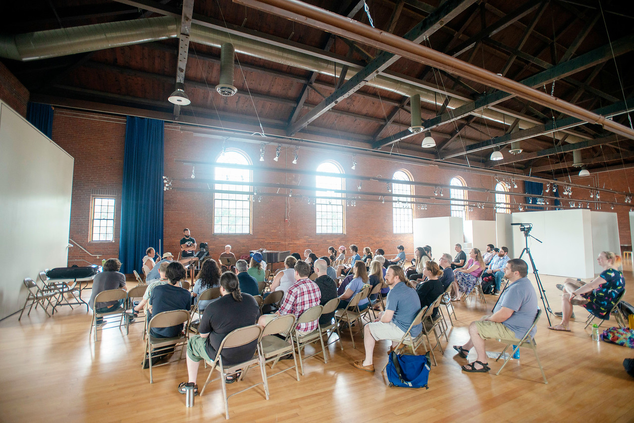 The VCFA community listens to a talk by the members of the Sirius Quartet at VCFA's Alumni Hall during the summer 2018 residency (Photo by Jay Ericson, courtesy VCFA)