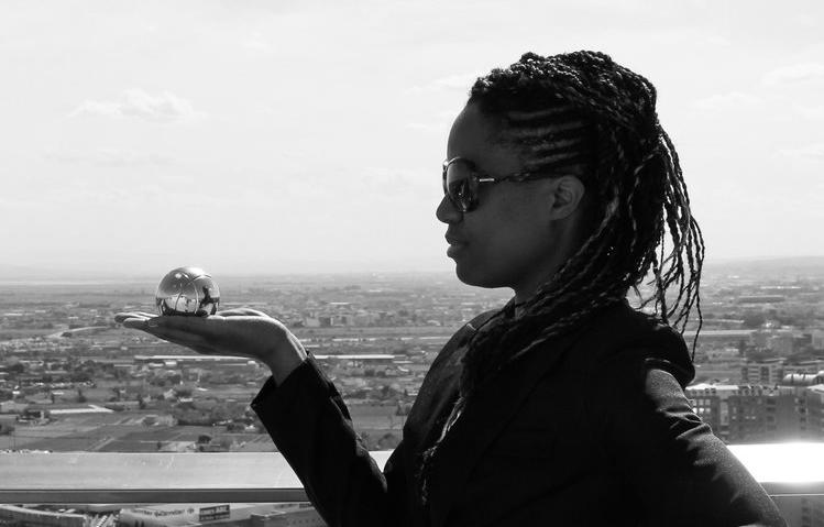 Karlyne Félix holding a glass globe