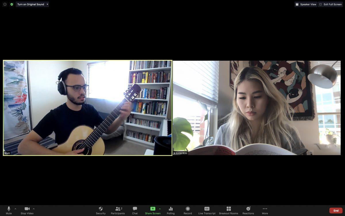 A zoom screenshot of a guitar lesson. Matt playing guitar and Jiji following along with the score.