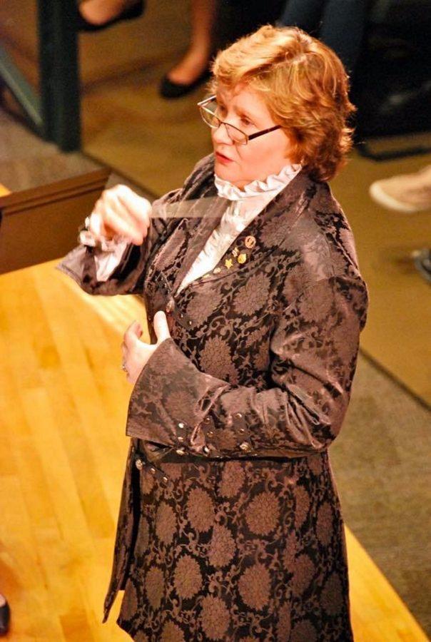 A close up of Julie Giroux conducting