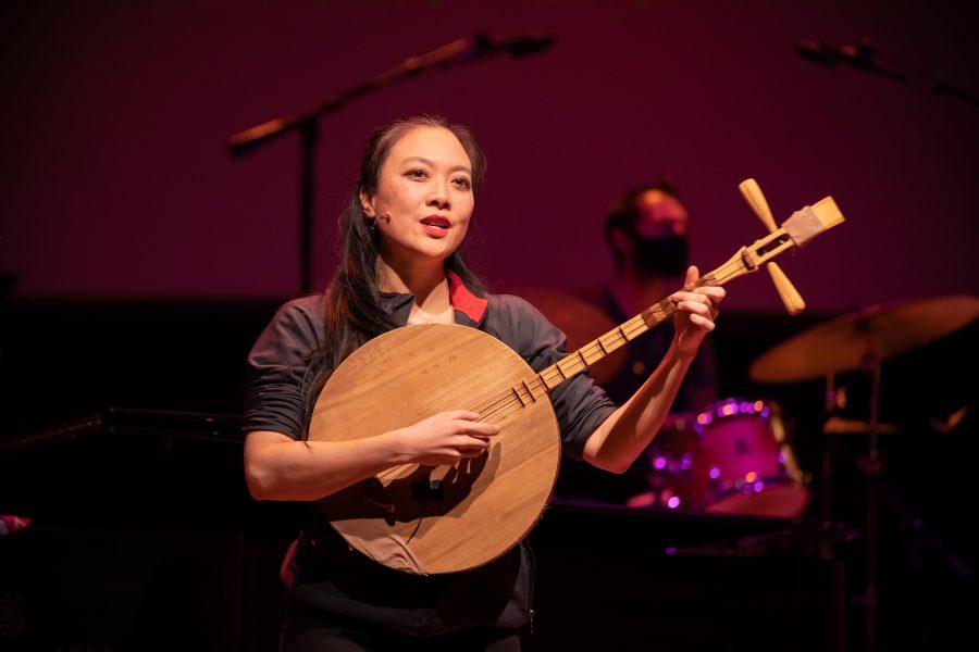 Jen Shyu  playing a moon lute. (Photo by Wolf Daniel, courtesy of Roulette Intermedium)