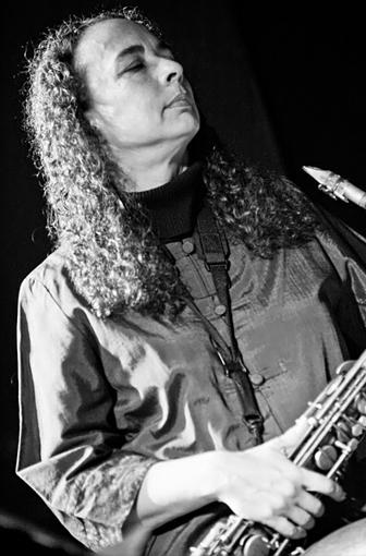 Erica Lindsay holding her saxophone (Photo by Jean M. Laffitau)